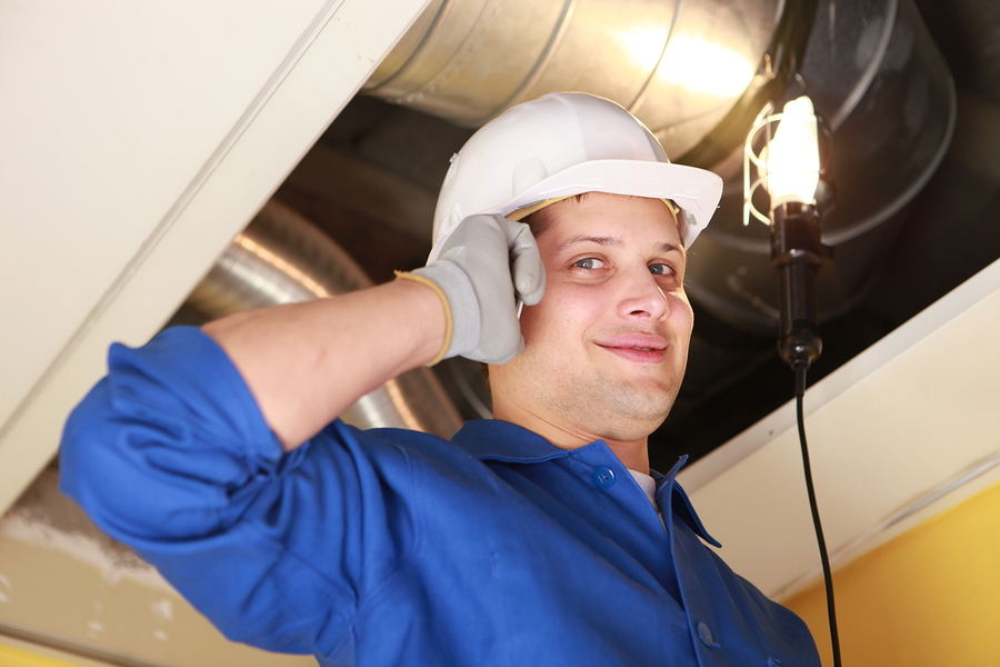 bigstock-Manual-worker-inspecting-air-c-37132750